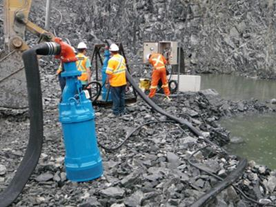 Tsurumi submersible pumps being installed in an open pit